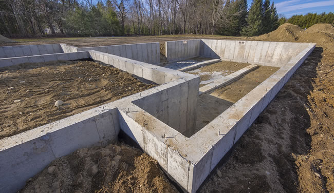 Concrete foundations in aurora colorado quality contracting for Slab foundation vs basement
